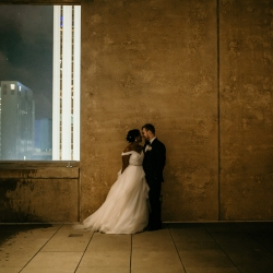 Bride and groom pose on the terrace of The Mint during their summer wedding captured by Kelly Meyers Photography