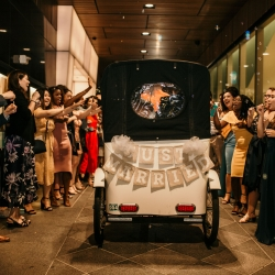 Kelly Meyers Photography captures the getaway of a bride and groom as they leave their Charlotte, North Carolina Wedding