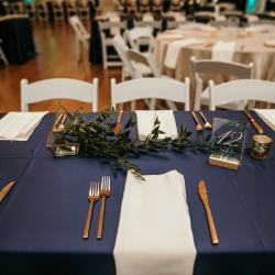 Gold flatware and lush navy linens are the perfect accents for a modern summer wedding at The Mint