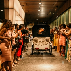 Peddicap decorated for the event was the perfect getaway car for a summer bride and groom married at The Mint Museum Uptown