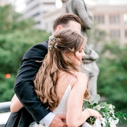 Kieran Claire Photography captures a bride and groom overlooking the city of Charlotte during their spring wedding coordinated by Magnificent Moments Weddings
