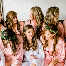 Bride is all laughs as she and her bridesmaids get hair and make up from Lovely by Lindsey before her spring wedding in Charlotte, North Carolina