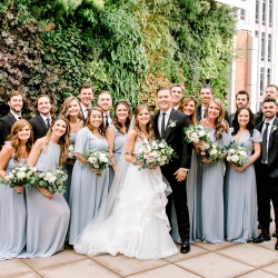 Bride and groom pose with their bridal party during their spring wedding at Foundation for the Carolinas