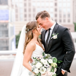 Bride and groom share a sweet moment during their spring wedding at Foundation for the Carolinas