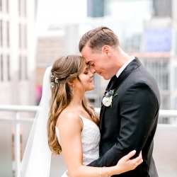 Kieran Claire Photography captures a bride and groom and the Charlotte skyline during their wedding at Foundation for the Carolinas