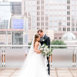 The Charlotte skyline creates the perfect backdrop for photographer Kieran Claire during a spring wedding at Foundation for the Carolinas