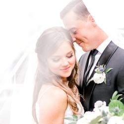 Kieran Claire Photography captures a bride and groom embracing on their wedding day at Foundation for the Carolinas