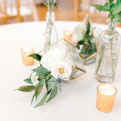 Modern glass terrariums filled with fresh flowers by Jimmy Blooms were the perfect accents to a spring wedding at Foundation for the Carolinas