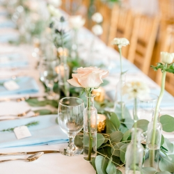 Simple bud vases by Jimmy Blooms create an elegant table setting for a spring wedding captured by Kieran Claire Photography