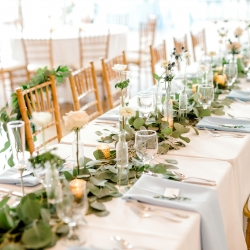 Greenery runners and bud vases by Jimmy Blooms created a romantic feel for an elegant spring wedding