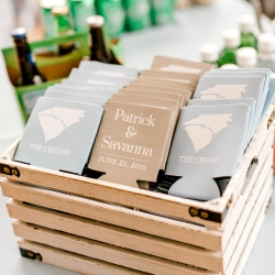 Custom koozies kept guests drinks cool during a spring wedding captured by Kieran Claire Photography