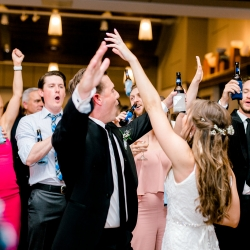 Bride and groom having fun on the dance floor to music provided by Split Second Sound during their spring wedding at Foundation for the Carolinas