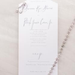 Kieran Claire Photography captures a gray and wedding invitation suite for a spring wedding at Foundation for the Carolinas