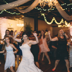 Bride dancing during her wedding reception at the Bottle Factory