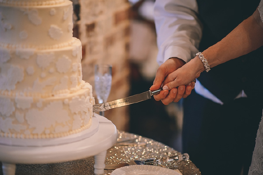 Bride and groom cutting their wedding cake.