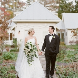 Bride and groom share a smile during their fall wedding planned by Magnificent Moments Weddings