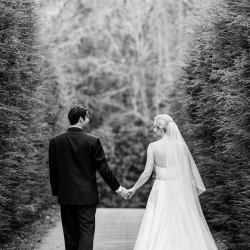 Bride and groom share a walk before exchanging vows during their Old Edwards Inn wedding