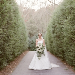Bride poses among the landscape of Old Edwards Inn