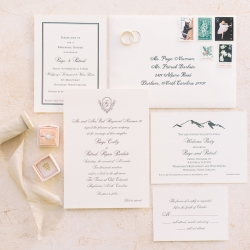 Stunning invitation suite show off the couples crest and mountain setting for a fall wedding