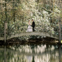 Krystal Kast Photography captures a bride and groom on a stunning bridge before during a romantic first look