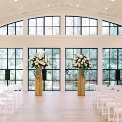 Stunning ceremony space at Old Edwards Inn is accent with large floral centerpieces created by Floressence
