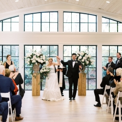 Bride and groom celebrate after exchanging vows during their fall wedding planned by Magnificent Moments Weddings