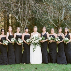 Krystal Kast Photography captures a bride with her bridesmaid who all work elegant black gowns