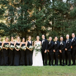 Bride and groom pose with their bridal party during their fall wedding at Old Edwards Inn