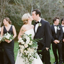 Bride and groom share a kiss captured by Krystal Kast Photography