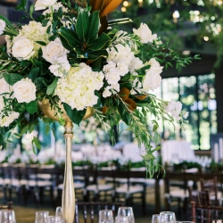 Tall centerpieces created by Floressence are the perfect table settings for a fall wedding designed by Magnificent Moments Weddings