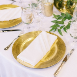 Simple gold charges, white linens, and crisp white napkins are the perfect setting for a fall wedding at Old Edwards Inn