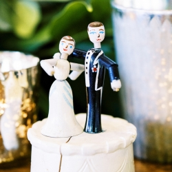 Custom cake toppers show of the bride and grooms personality all captured by Krystal Kast Photography