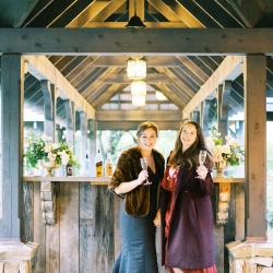 Bridal party shares a toast as they celebrate a fall wedding at Old Edwards Inn