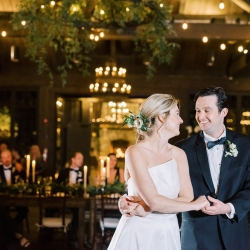 Bride and groom share a smile during their first dance planned and coordinated by Magnificent Moments Weddings