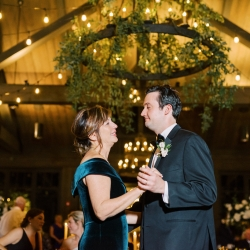 Groom dances with his mother during his wedding reception planned by Magnificent Moments Weddings