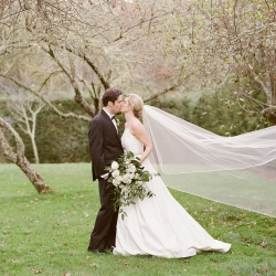 Brides stunning veil flows in the wind during her fall wedding at Old Edwards Inn