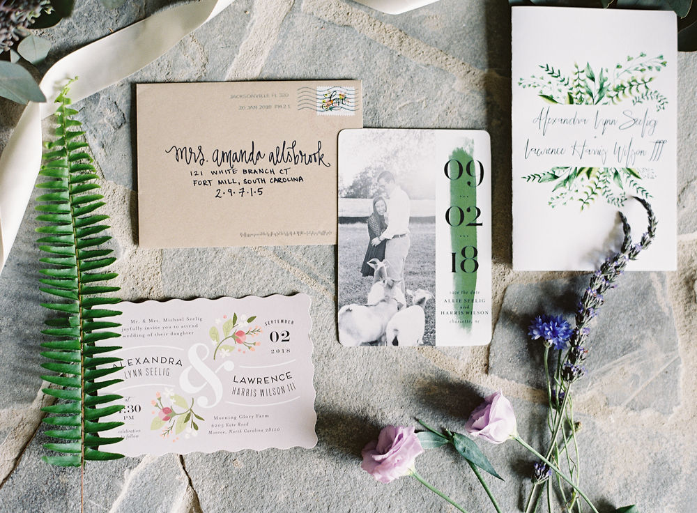 Custom Invitation suite that has great floral details for a flower filled wedding at Morning Glory Farm
