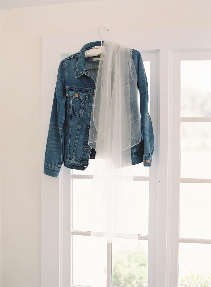 Casual denim jacket for a boho bride to wear during her fall wedding at Morning Glory Farm
