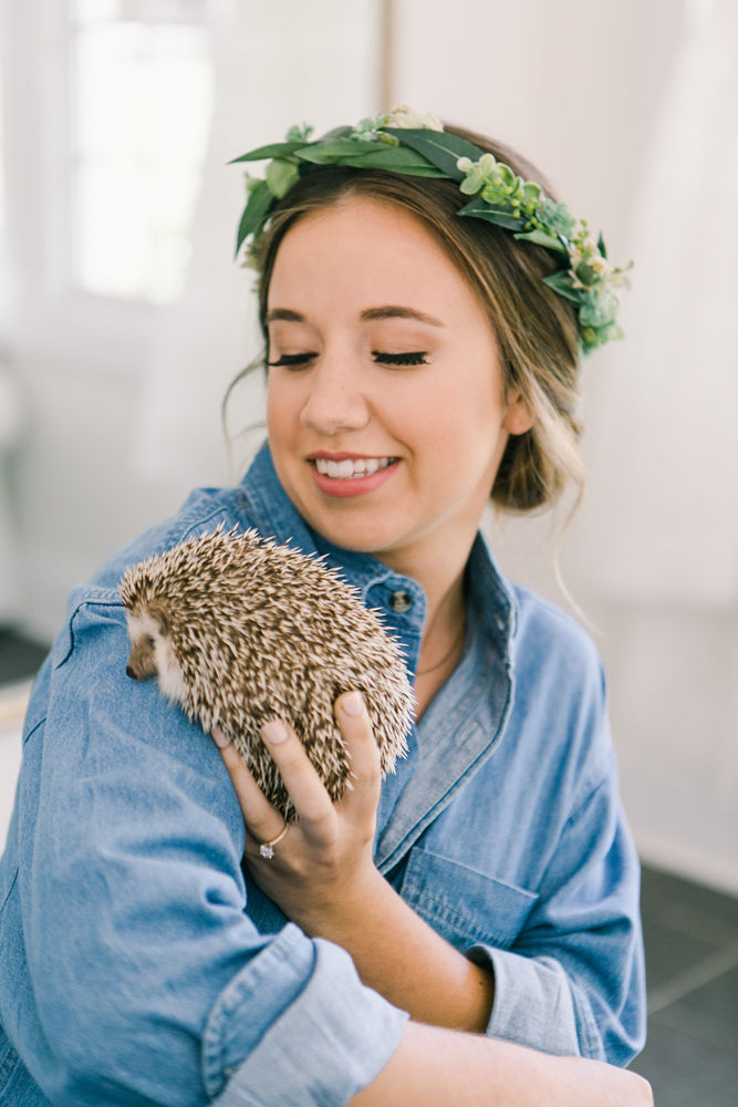 Bride shares a sweet moment with her pet hedgehog as she prepares for her wedding wearing a floral crown created by Jimmy Blooms