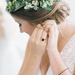 Bride has a stunning updo created by Lovely by Lindsey and accented by a sweet floral crown created by Jimmy Blooms