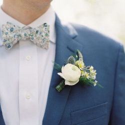 Detail shot of a grooms fun floral tie and stunning boutineer created by Jimmy Blooms