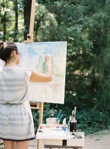 Artist from Laddie Neil Art creates a custom piece of artwork during a fall wedding at Morning Glory Farm coordinated by Magnificent Moments Weddings
