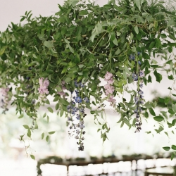 Amazing greenery chandelier created by Jimmy Blooms features colorful buds dripping to the tables below created the perfect setting for a fall wedding at Morning Glory Farm