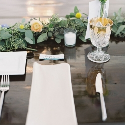 Sweet table setting shows off a stunning garland accented by colorful buds from Jimmy Blooms and vintage goblets from Evermore Rentals for a fall wedding at Morning Glory Farm