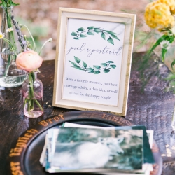 Vintage postcards serve as the guestbook placed on a vintage table surrounded by sweet buds from Jimmy Blooms at a fall wedding at Morning Glory Farm