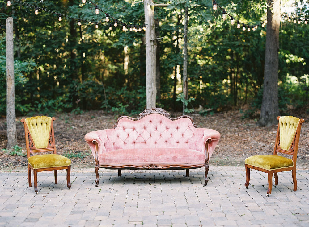 Vintage seating from Evermore Rental Compnay shows of the brides boho taste during her fall wedding at Morning Glory Farm