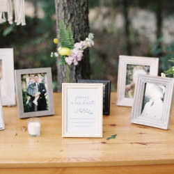 Memorial table lined with pictures of past loved ones creates and intimate feel for a fall wedding at Morning Glory Farm