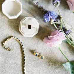 Maggie Colleta Photography captures details of unique bridal jewelry complete with delicate black stones