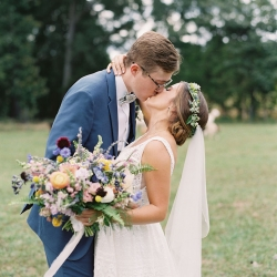 Bride and groom embrace during their fall wedding at Morning Glory Farm captured by Maggie Colleta Photography