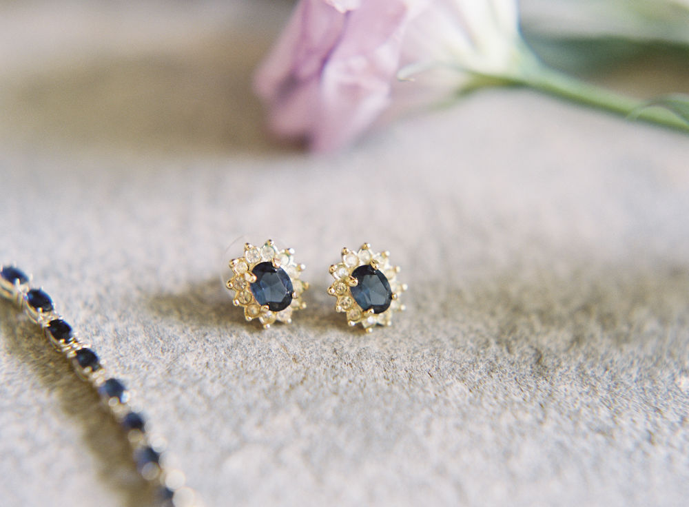 Maggie Colleta Photography captures detail shot of unique bridal jewelry with black stones